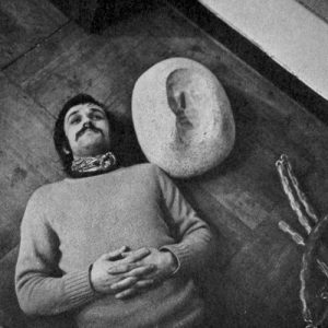Alighiero Boetti near his self-portrait in negative, 1969