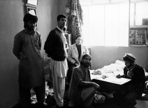The collaborator Massimo Mininni with the Sufi master Barang and his assistants, Peshawar Pakistan, courtesy of Alighiero Boetti Archive