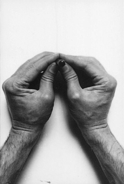 Two hands a pencil, photo by Gianfranco Gorgoni